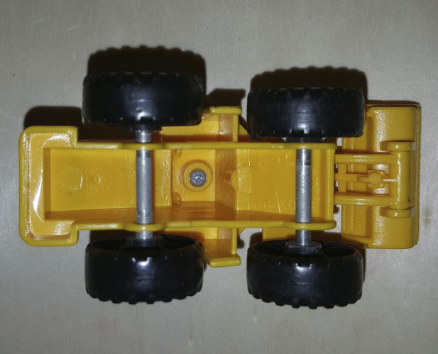 Bottom of a plastic toy digger